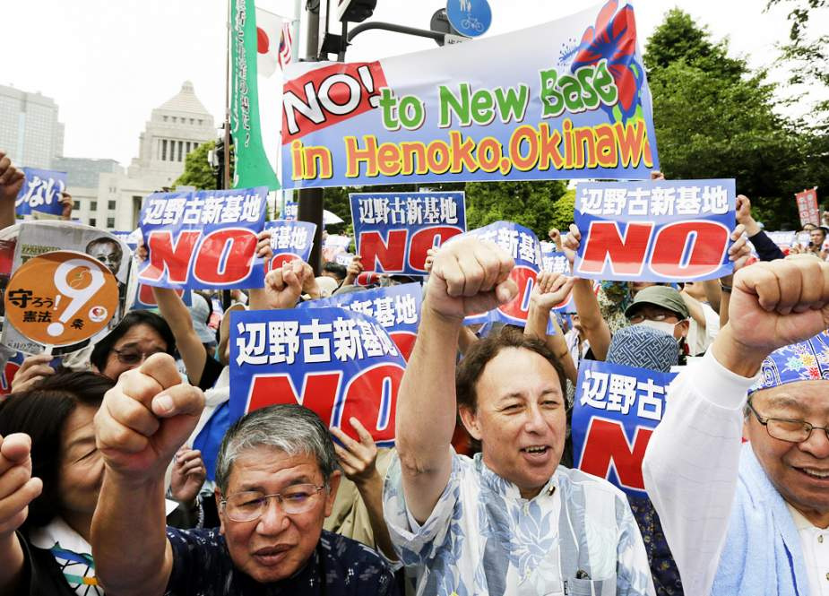 People protest the planned relocation and expansion of a US air base on Okinwa Island, at a park on the island's capital of Naha, August 11, 2018. (Photo by AP)