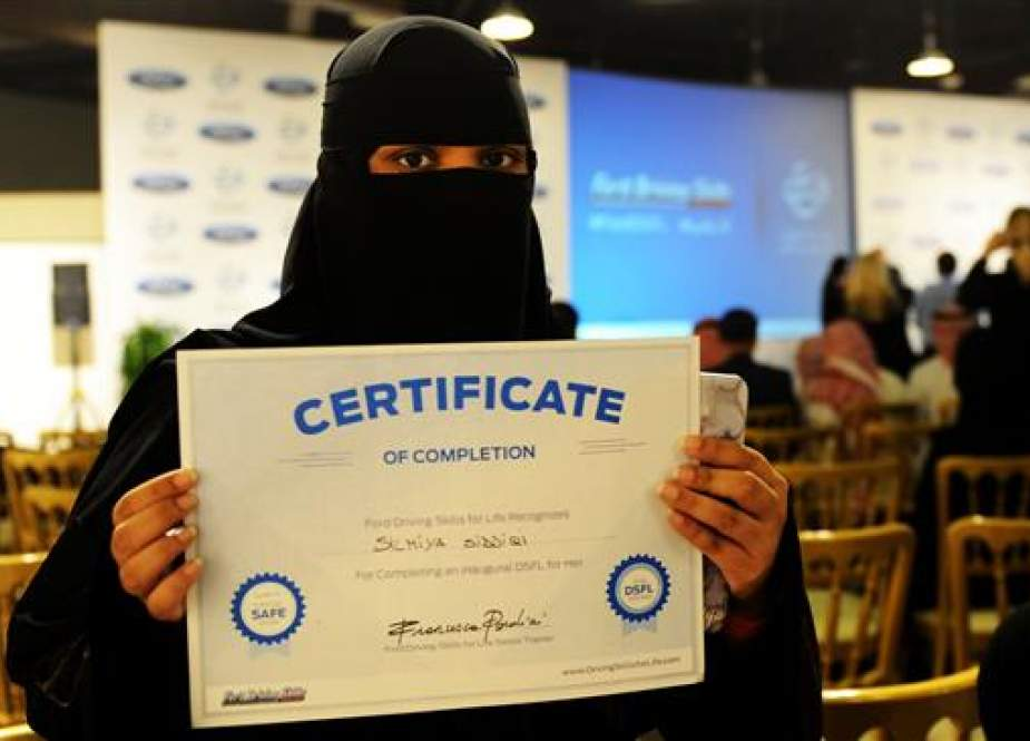 In this file photo taken on March 7, 2018, a Saudi woman poses for a photo with a certificate after completing a driving course in Jeddah. (Photo by AFP)