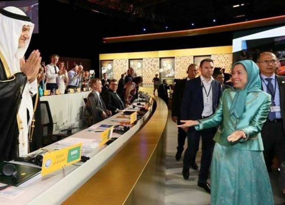 Prince Turki bin Faisal Al Saud (L) greets Maryam Rajavi, chief of the MKO terror group during a gathering in Paris.jpg