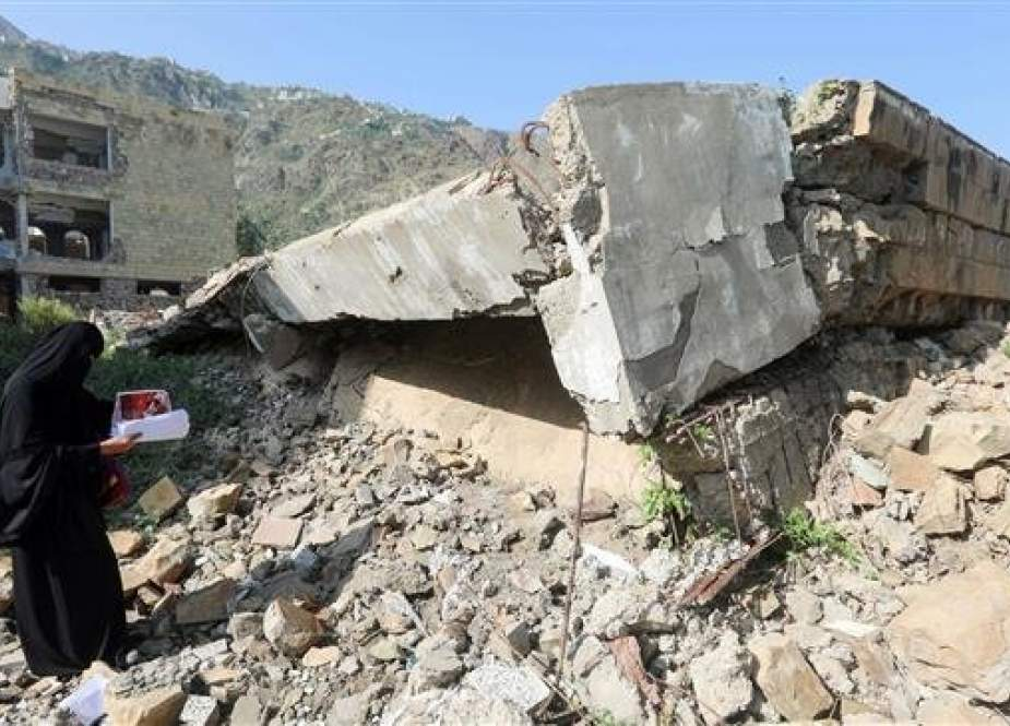 The file photo shows damage at the site of an airstrike on a school in Ta