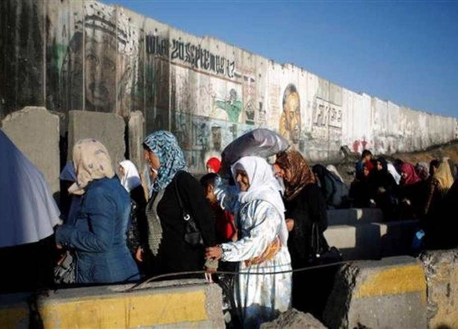 Palestinian women are waiting to cross through the Qalandiya checkpoint.jpg