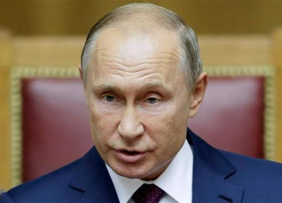 The file photo shows Russian President Vladimir Putin during a plenary session of the Second Eurasian Women