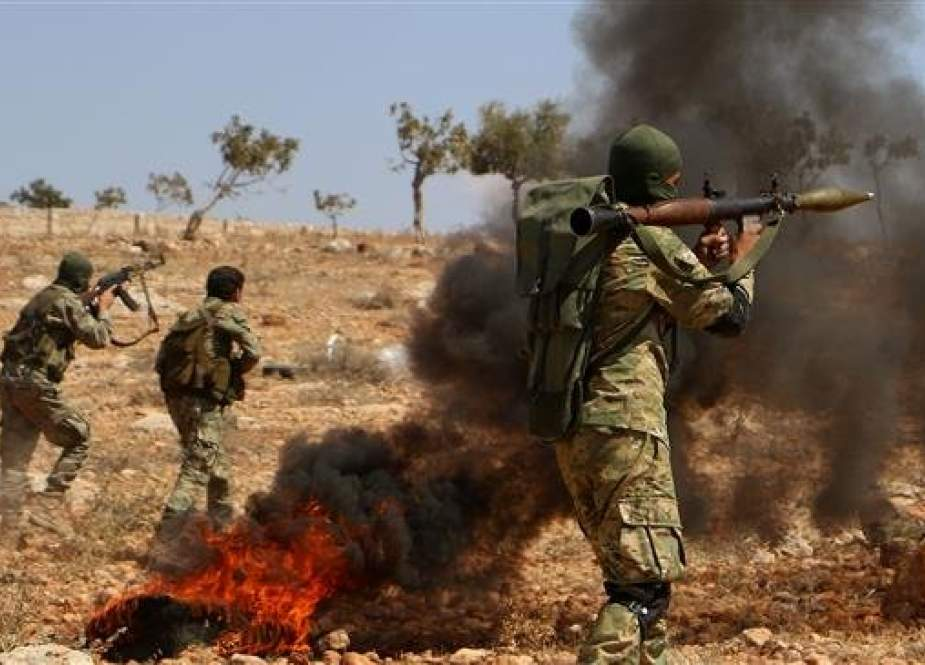 Militnats from the so-called National Liberation Front (NLF), an alliance of anti-Damascus militant groups supported by Turkey, take part in combat training at an unknown location in the northern countryside of Syria