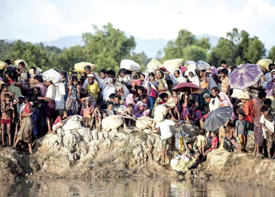 This file photo, taken on October 10, 2017, shows Rohingya refugees fleeing from Myanmar at the Naf River in Whaikyang, on the border with Bangladesh. (By AFP)
