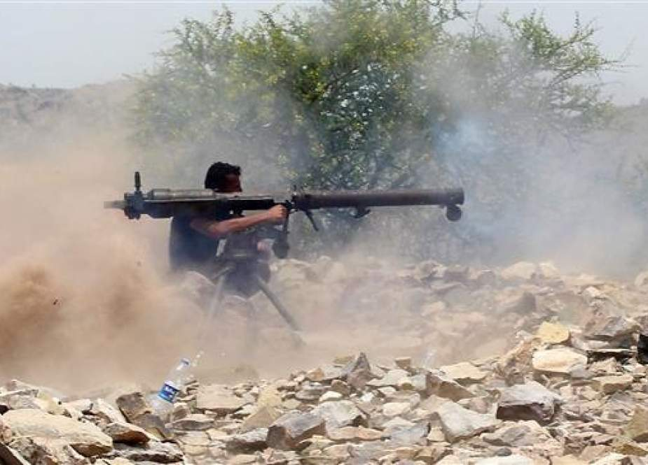 A militant recruited by the Saudi Arabia-led coalition invading Yemen fires a recoilless rocket launcher weapon as he and his fellow militants wage violence on the frontline of Kirsh between the provinces of Ta'izz and Lahij, southwestern Yemen, July 1, 2018. (Photo by AFP)