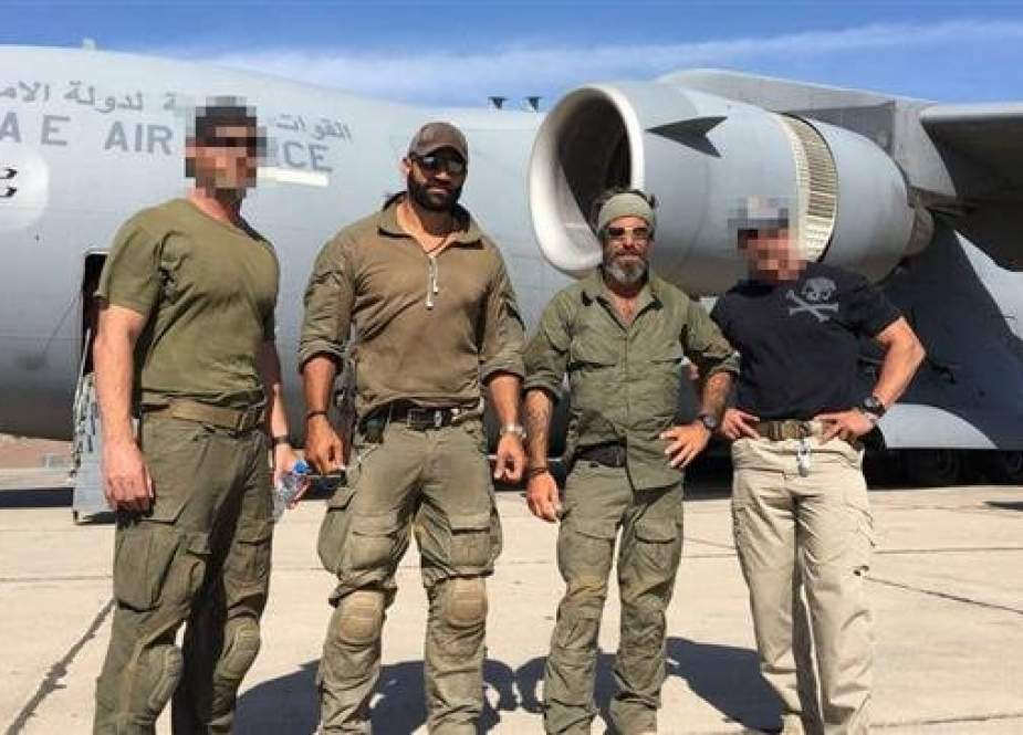 Undated photo shows Abraham Golan (2nd-R), the founder of the American Spear Operations Group security firm, which was reportedly contracted by the UAE, and Isaac Gilmore, US Navy SEAL and member of the firm, standing in front of an Emirati military plane. (Photo provided to BuzzFeed by Golan)