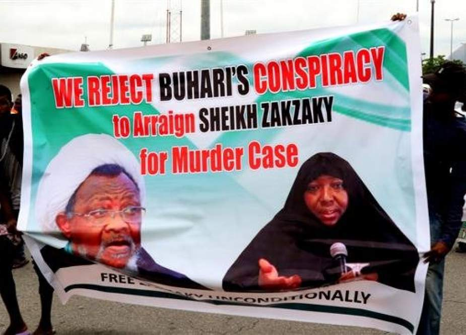 The file photo shows supporters marching with a banner to press for the release of Nigerian Muslim cleric Ibrahim Zakzaky on May 14, 2018 in Abuja. (Photo by AFP)