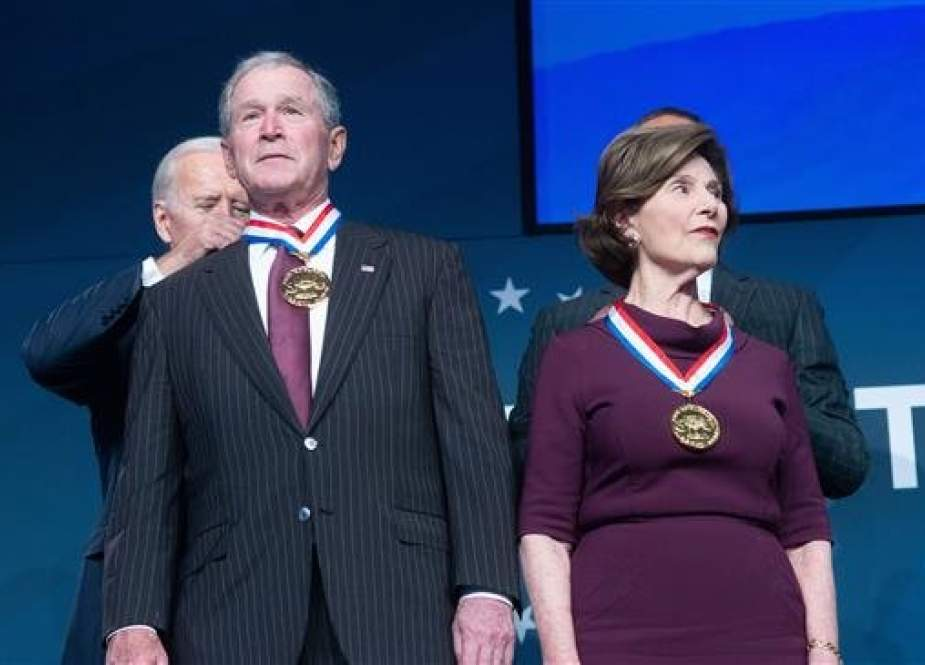 Former Vice President Joe Biden presents George W. Bush and Laura Bush the 2018 Liberty Medal at the National Constitution Center, on November 11, 2018, in Philadelphia, Pennsylvania. (Photo by AFP)