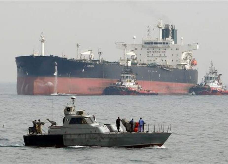 Iranian oil tanker NITC Artavil prepares to dock at Kharg Island in the Persian Gulf as Iranian coast guards patrol the waters. (File photo)