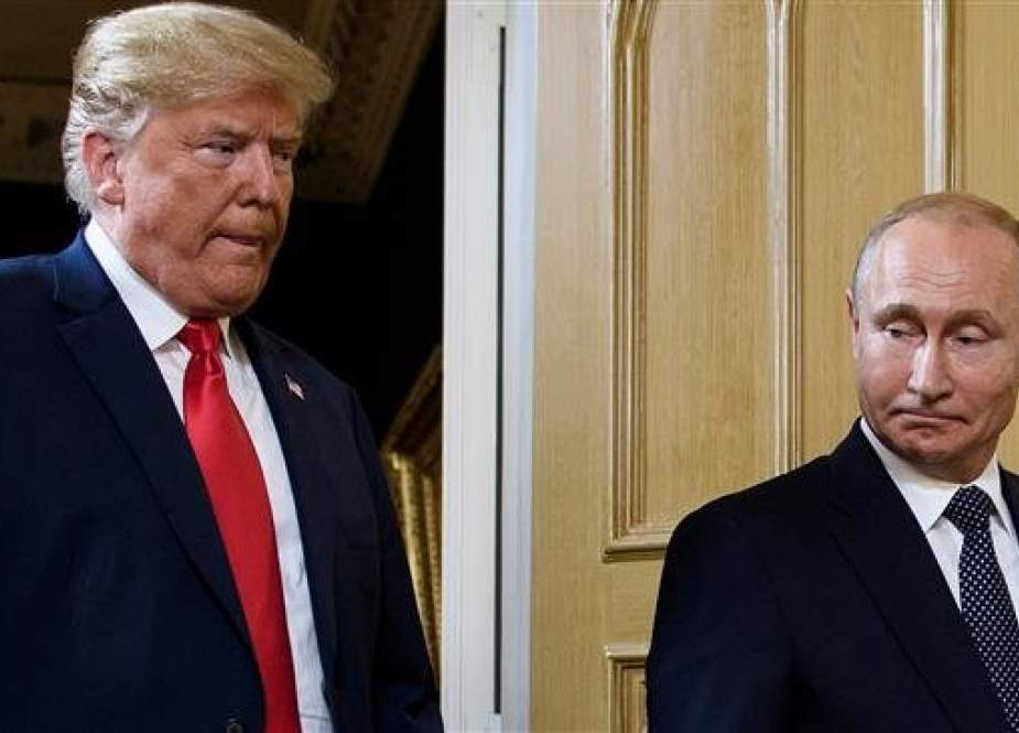 In this photo taken on July 16, 2018, US President Donald Trump (L) and Russian President Vladimir Putin arrive for a meeting in Helsinki, Finland. (Photo by AFP)
