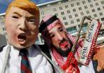 Activists dressed as US President Donald Trump and Saudi Crown Prince Mohammed bin Salman participate in a demonstration calling for sanctions against Saudi Arabia in front of the US State Department in Washington, October 19, 2018. (Photo by Reuters)