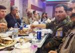 This picture dated November 11, 2018 shows US forces dining alongside Washington-backed Kurdish militants in the northern Syrian city of Manbij. (Photo by Hurriyet Daily News)