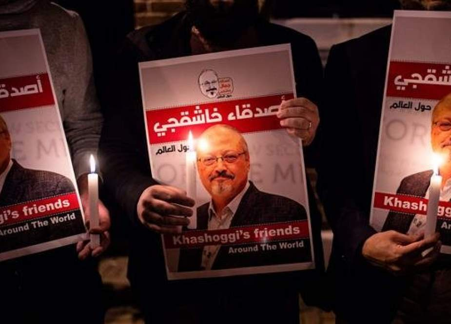 People hold posters of slain Saudi journalist Jamal Khashoggi and candles during a gathering outside the Saudi consulate in Istanbul, Turkey, October 25, 2018. (Photo by AFP)