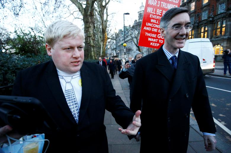 A Boris Johnson impersonator walks alongside Brexit supporting Conservative MP Jacob Rees-Mogg in Westminster, London, December 11, 2018.