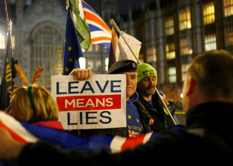 Pro-Brexit and anti-Brexit demonstrators face each other opposite, the Houses of Parliament, in Westminster, central London, December 11, 2018.