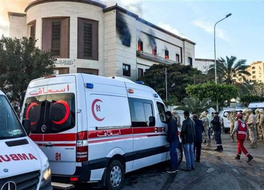 A picture taken on December 25, 2018 shows ambulances, paramedics, and security officers at the scene of an attack outside the Libyan foreign ministry headquarters in the capital Tripoli. (AFP)
