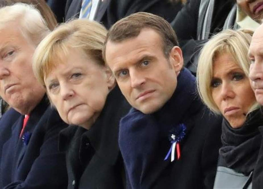 (From L) US President Donald Trump, German Chancellor Angela Merkel, French President Emmanuel Macron and his wife Brigitte Macron, and Russian President Vladimir Putin attend a ceremony at the Arc de Triomphe in Paris on November 11, 2018 as part of commemorations marking the 100th anniversary of the 11 November 1918 armistice, ending World War I. (Photo by AFP)
