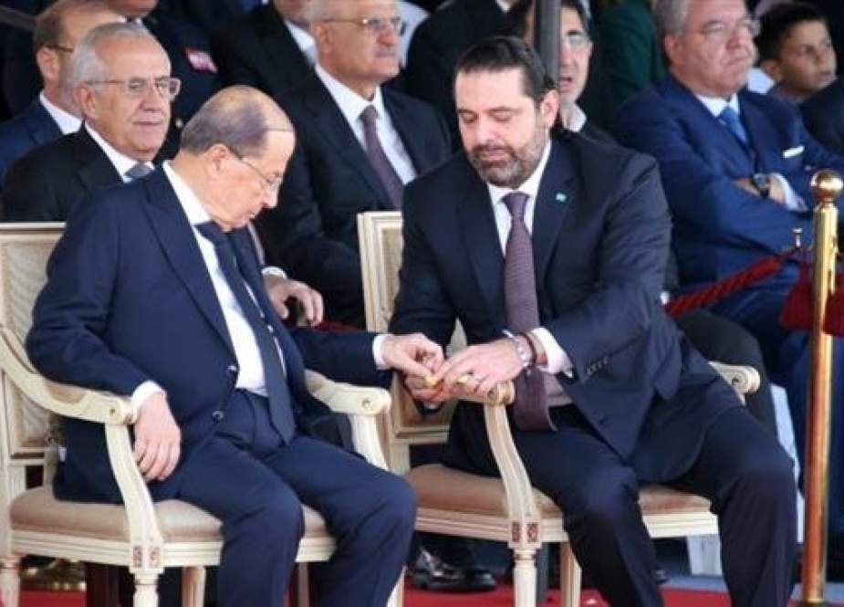 Lebanese President Michel Aoun (L) and Lebanese Prime Minister-designate Saad al-Hariri attend a military parade to celebrate the 75th anniversary of Lebanon