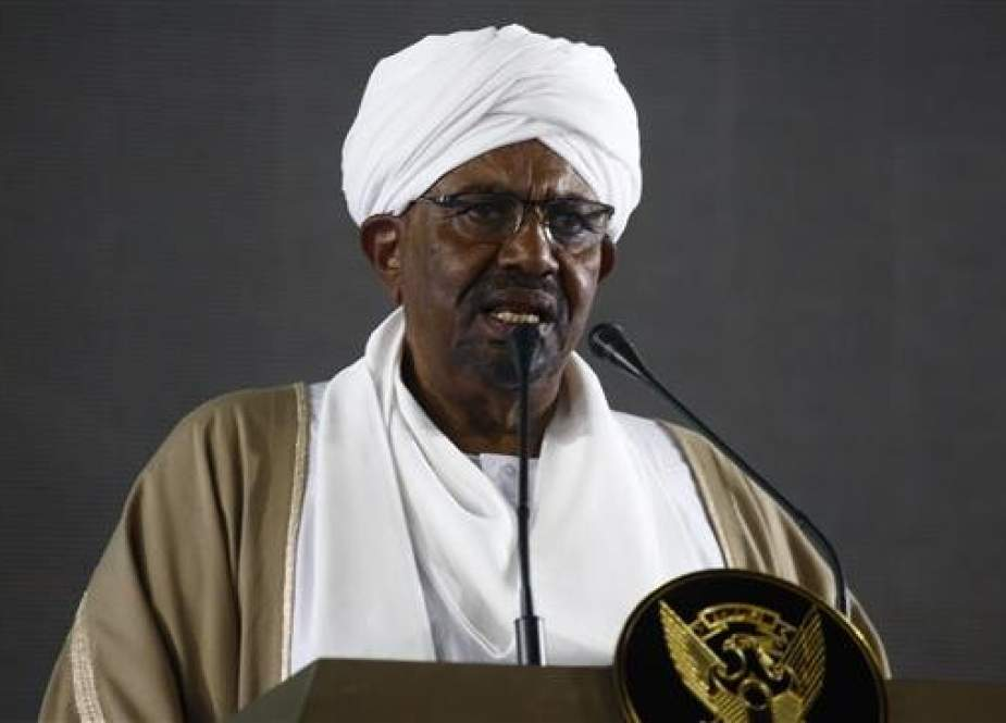 Sudanese President Omar al-Bashir delivers a speech on December 31, 2018, at the presidential palace in the capital Khartoum. (Photo by AFP)