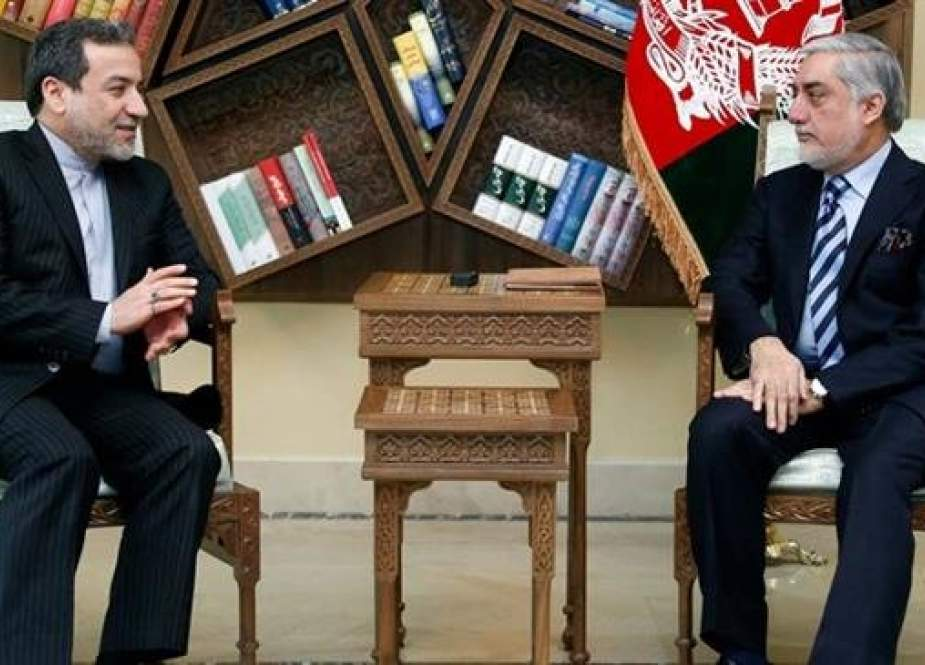 Iranian Deputy Foreign Minister for Political Affairs Abbas Araqchi (L) and Afghanistan