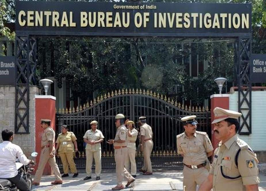In this file photo taken on October 26, 2018 Indian police stand in front of the regional office of the Central Bureau of Investigation (CBI) prior to a protest staged by members of the Karnataka State National Congress Party in Bangalore, following the dismissal of Alok Verma of CBI head. (Photo by AFP)