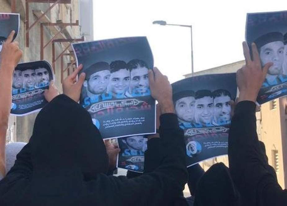 Protesters hold posters depicting martyrs killed in anti-regime rallies in Diraz, Bahrain, January 11, 2019.