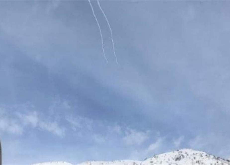 The photo shows trails of missiles purportedly fired by Israel's so-called Iron Dome system in an attempt to intercept an alleged Syrian projectile over Mount Hermon in the Israeli-occupied Golan Heights, January 20, 2019. (Photo by Times of Israel)