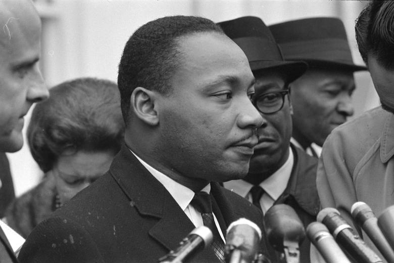 Martin Luther King Jr. speaks after meeting with President Lyndon B. Johnson to discuss civil rights at the White House in Washington, December 3, 1963.