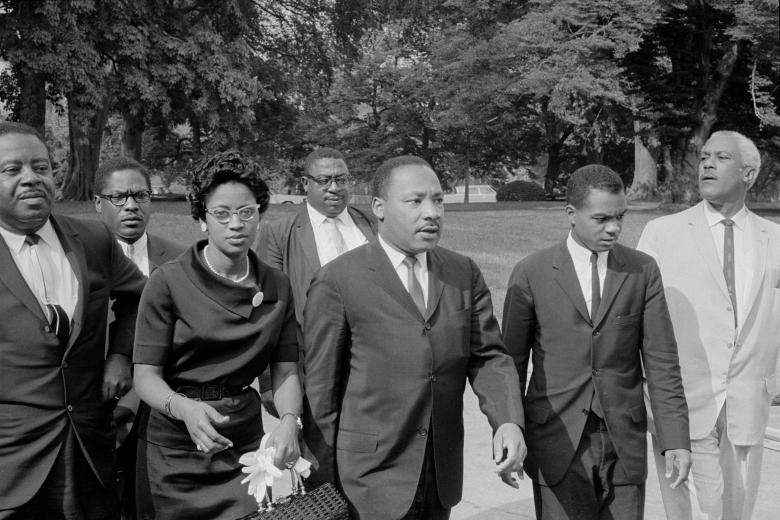 Martin Luther King Jr. (3rd R) is seen in an unknown location on August 5, 1965, a day before President Lyndon B. Johnson signed the Voting Rights Act into law.