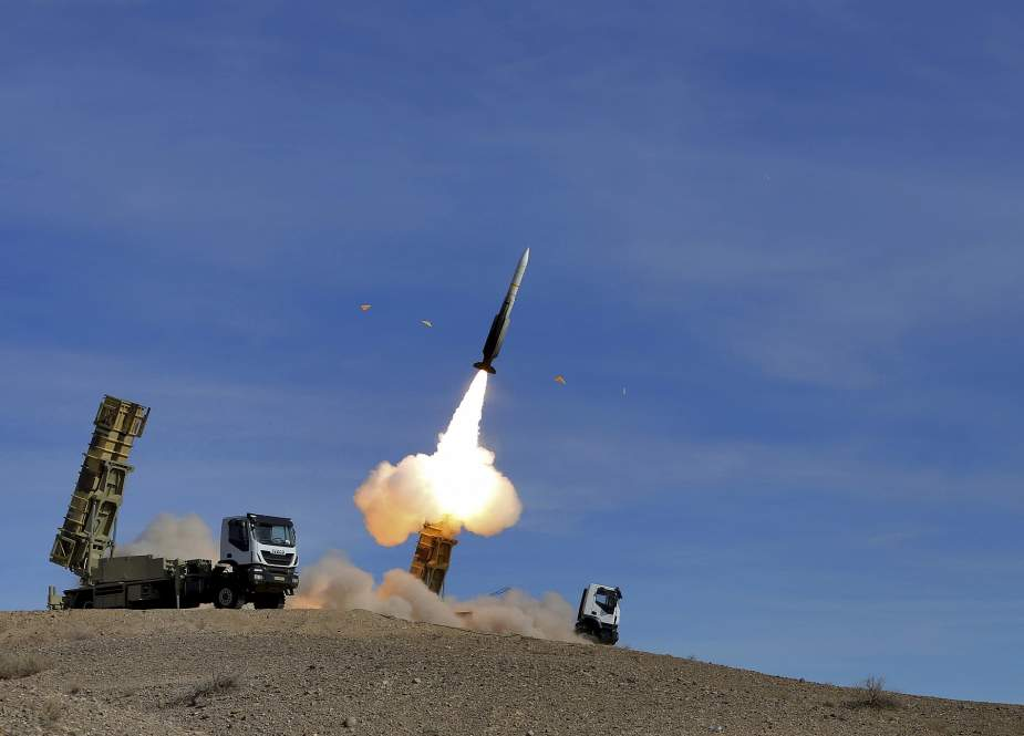 A handout picture made available by the Iranian Army office shows the Sayad missile being launched from the Talash missile system during air defense drills in an undisclosed location in Iran on November 5, 2018 (Photo by AFP)