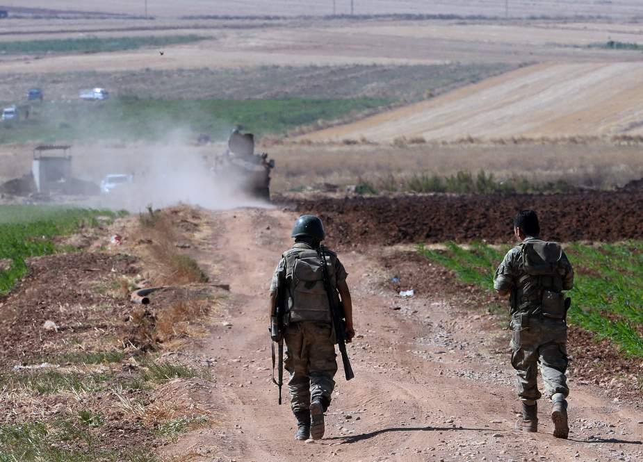 Turkish soldiers patrol the border area with Syria.jpg