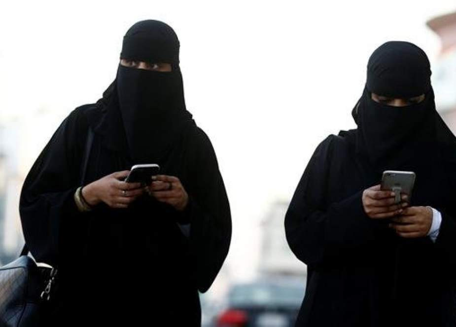 In this file picture, Saudi women use their mobile phones in Riyadh, Saudi Arabia. (Photo by Reuters)