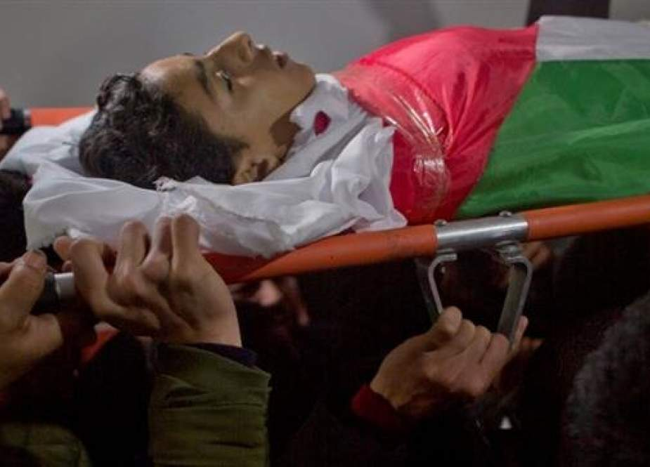 Palestinians bury 14-year-old killed during Gaza protest