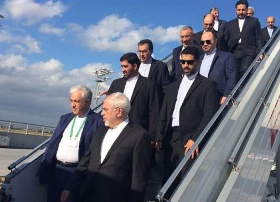 Iranian FM Mohammad Javad Zarif (R front) disembarks from a plane in this file photo.