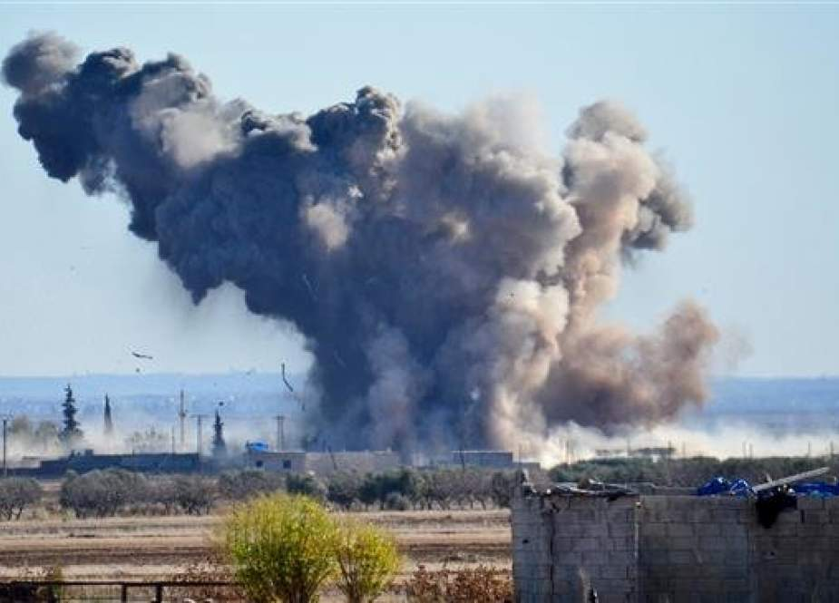 In this file picture, smoke rises after the US-led coalition hits purported Daesh positions in Brekida village in Aleppo, Syria. (Photo by Getty Images)