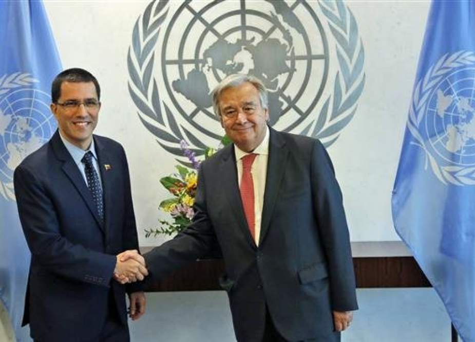 This file photo shows Venezuela's Minister of Foreign Affairs Jorge Arreaza (L) shaking hands with United Nations Secretary-General Antonio Guterres at the UN headquarters in New York, on August 25, 2017. (By AP)