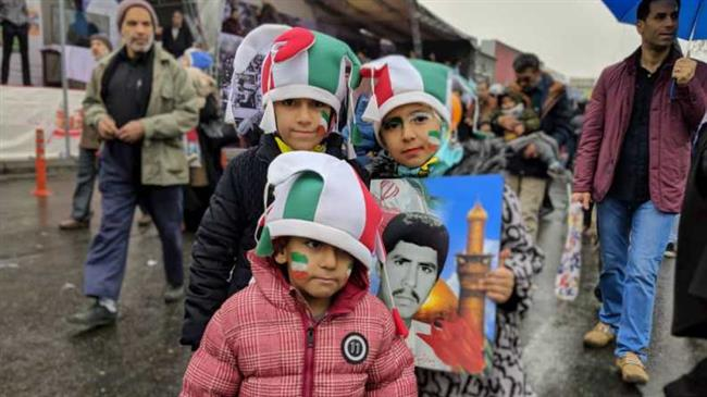 Iranian children are seen during a rally in Tehran February 11, 2019.