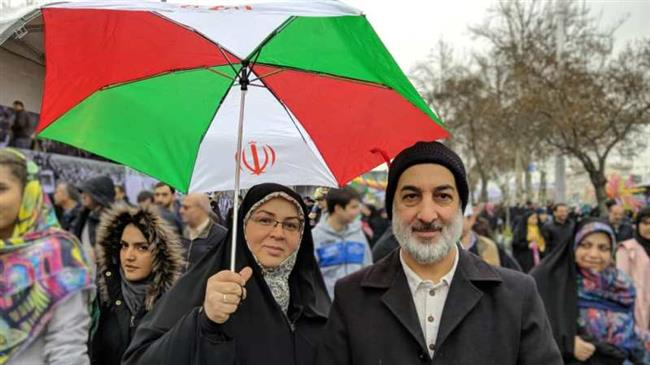 Iranians pose for a picture during a demonstration in Tehran, February 11, 2019.