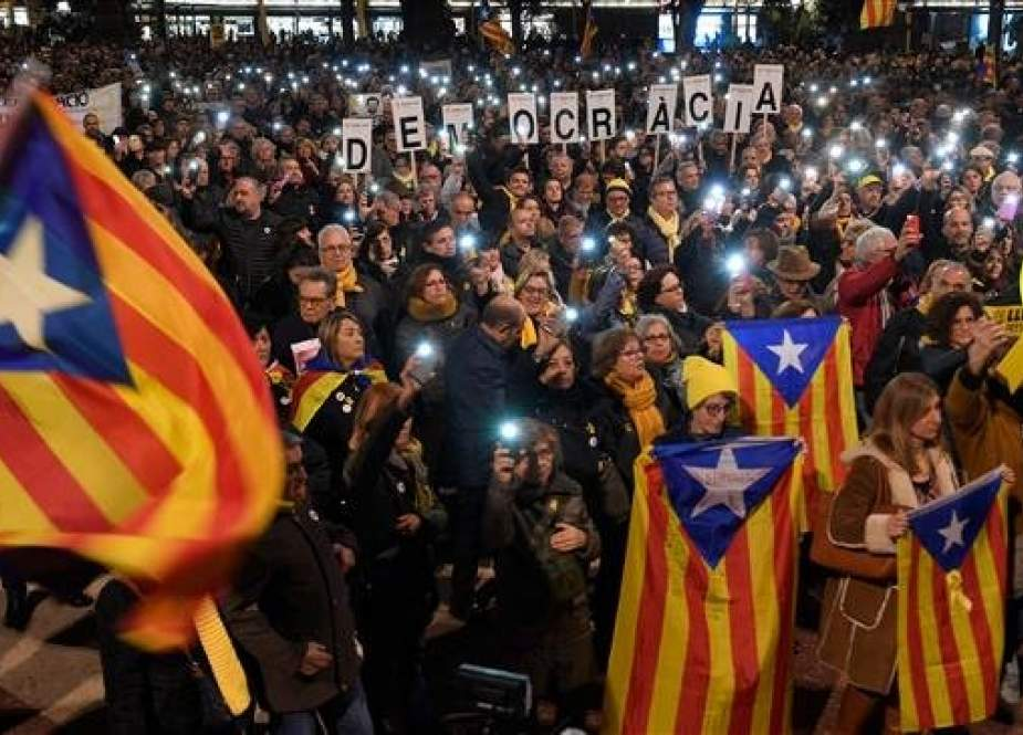 People take part in a demonstration in Barcelona against the trial of former Catalan separatist leaders on February 12, 2019. (AFP)