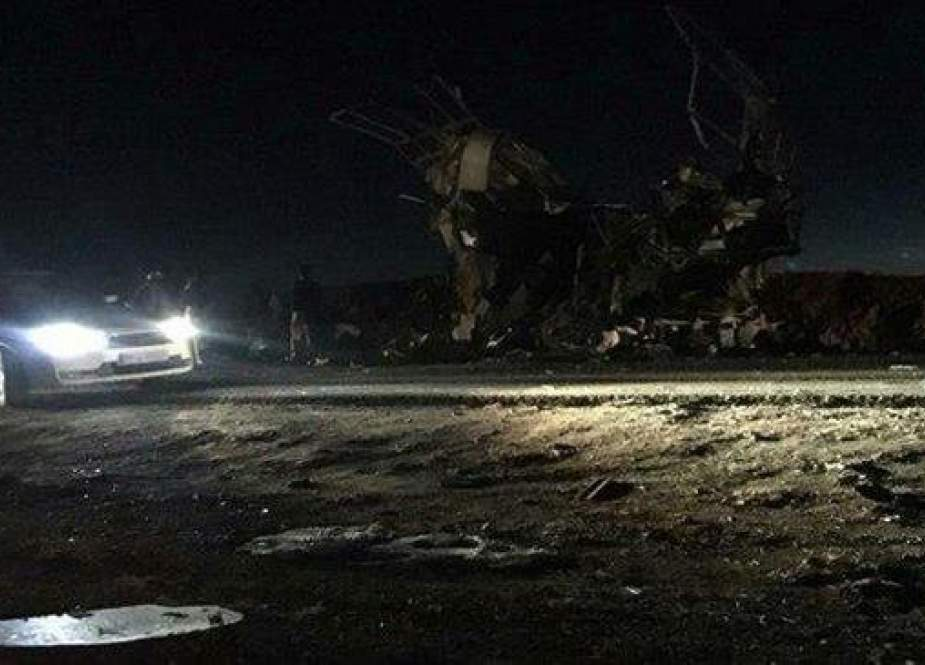 The remains of an IRGC personnel bus after it was targeted in a suicide attack in southeastern Iran on Wednesday, February 13, 2019