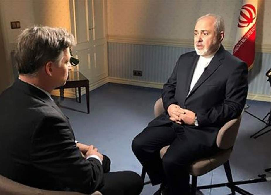 Iranian Foreign Minister Mohammad Javad Zarif (R) speaks to NBC News