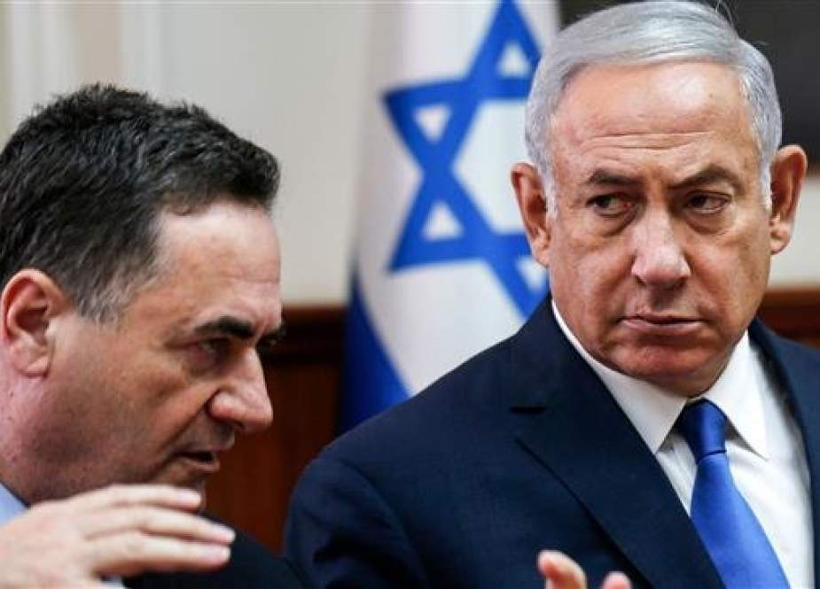The file photo shows Israeli Prime Minister Benjamin Netanyahu, right, listening to then Intelligence and Transportation Minister Israel Katz during the weekly cabinet meeting in Jerusalem al-Quds, September 5, 2018. (By AFP)