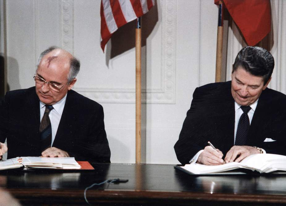 U.S. President Ronald Reagan and Soviet General Secretary Mikhail Gorbachev signing the INF Treaty in the East Room at the White House in 1987.