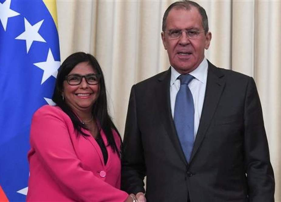Russian Foreign Minister Sergei Lavrov (R) and Venezuelan Vice President Delcy Rodriguez shake hands at the end of a joint press conference, following their meeting in the Russian capital of Moscow, on March 1, 2019. (Photo by AFP)