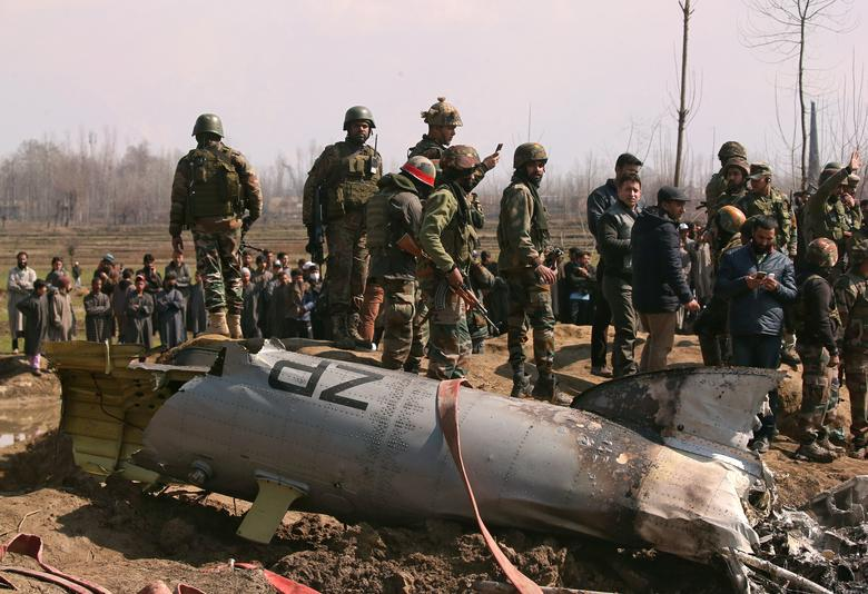 Indian soldiers stand next to the wreckage of an Indian Air Force helicopter after it crashed in Budgam district in Kashmir, February 27.