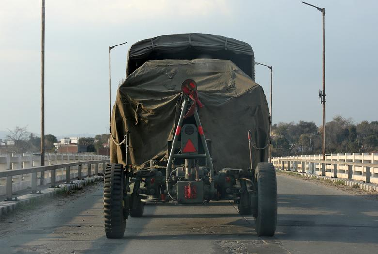 An Indian army artillery vehicle drives on a highway near Jammu, February 27.