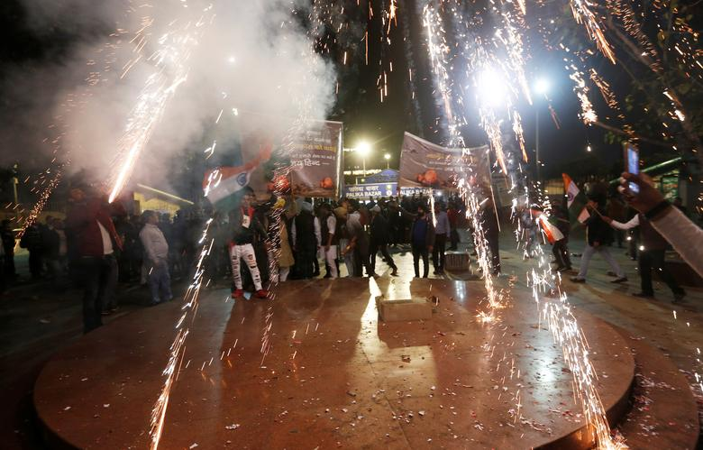 People burn firecrackers to celebrate after Indian authorities said their jets conducted air strikes on militant camps in Pakistani territory, in New Delhi, India, February 26.