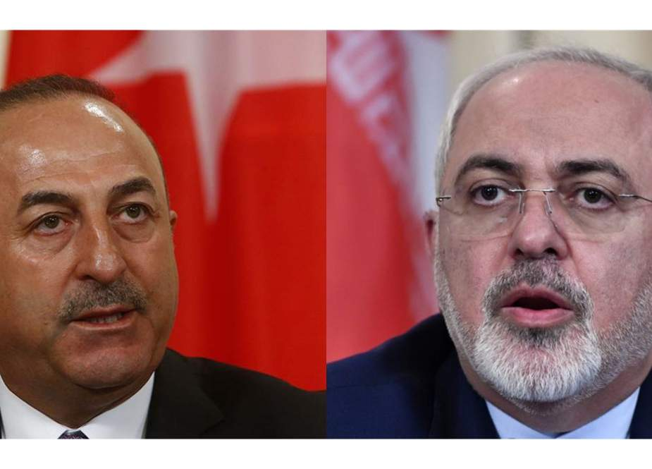 The file combination of pictures shows Iranian Foreign Minister Mohammad Javad Zarif (R) and his Turkish counterpart Mevlut Cavusoglu