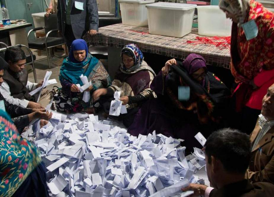 This file photo shows Bangladeshi election officials counting ballots at a polling station after voting ended in Dhaka, Bangladesh, on December 30, 2018.