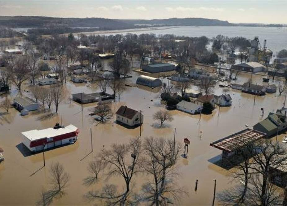 Homes and businesses are surrounded by floodwater in Hamburg, Iowa.jpg